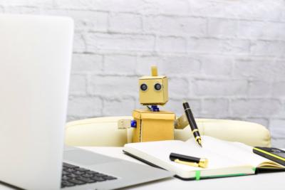A robot working at a desk